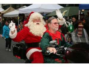 A Sea of Santa's..on Harleys-Small Businesses Giving Back