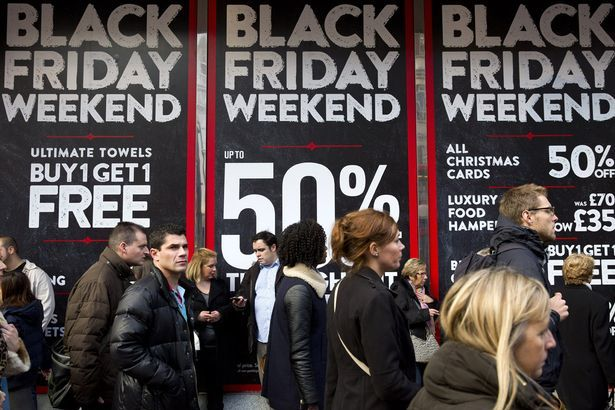 crowd-in-front-of-black-friday-posters