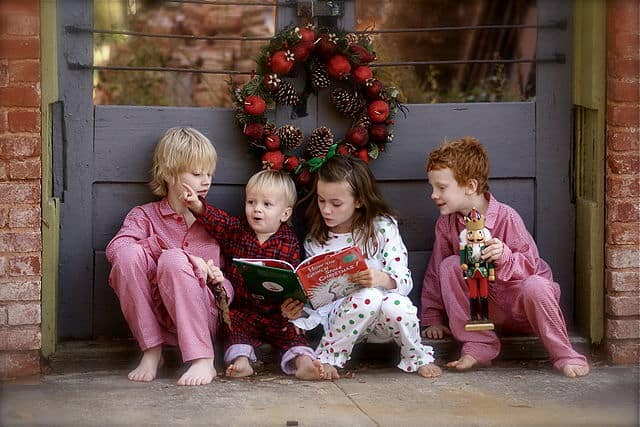 Children reading The Grinch by Dr. Seuss