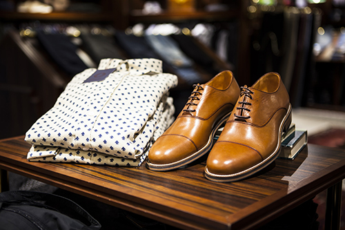 Mens dress shirt and shoes on display